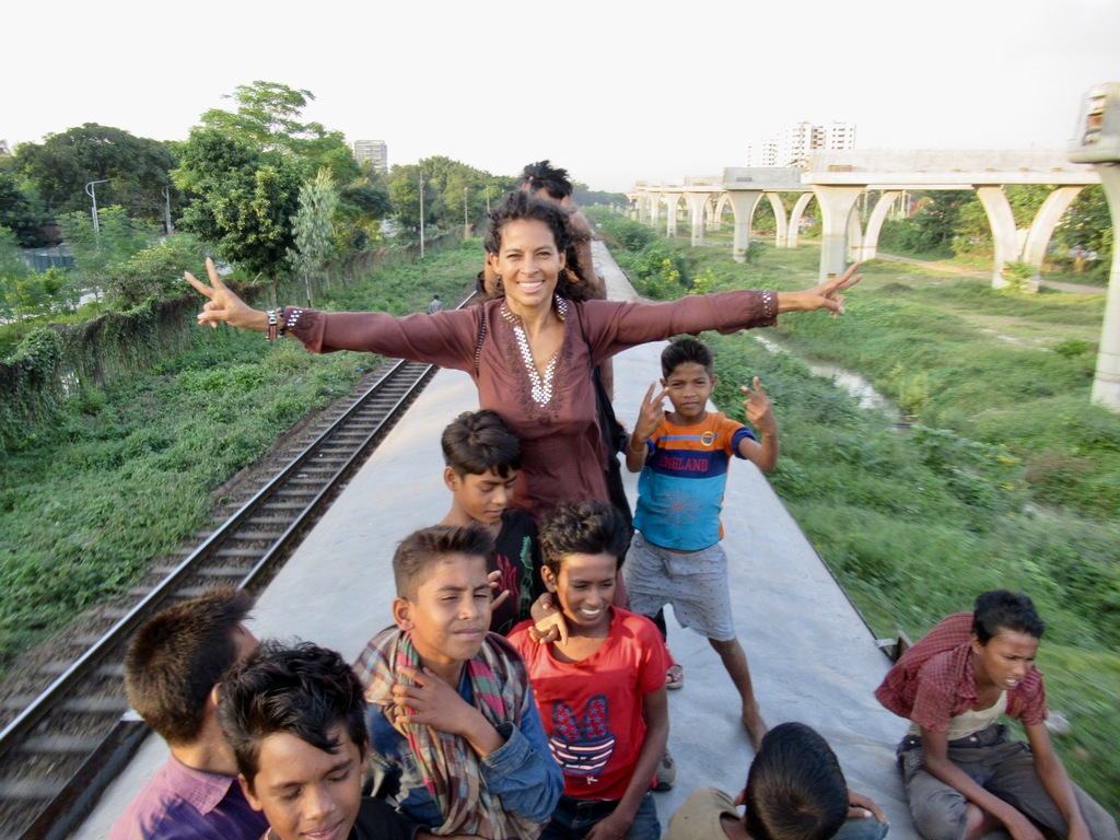 riding on the top of a train in Bangladesh