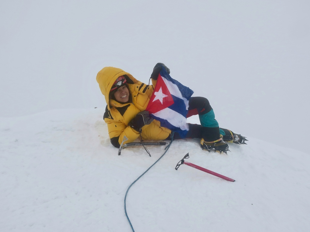Cuban flag in Huayna Potosi summit 6088m in Bolivia